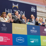 Hilton Worldwide President and Chief Executive Officer Christopher J. Nassetta, joined by hotel team members and executives from the company as well as majority shareholder Blackstone, rings the NYSE Opening Bell® to celebrate the company's reentry into the public market.